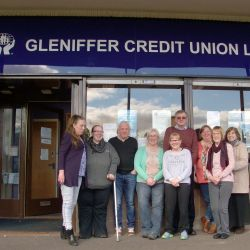 Staff outside credit union office
